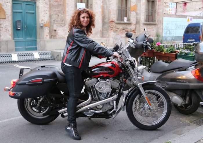 Violeta Ivanova from Bulgaria traveling on a motorcycle with his entire family.