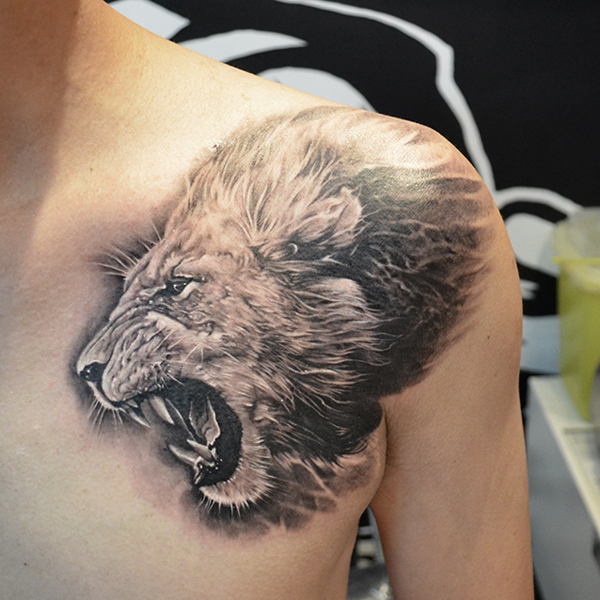lion tattoo on chest roaring